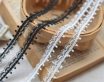 1/2 inch wide white( not snow white) or black lace trim price for 1 yard