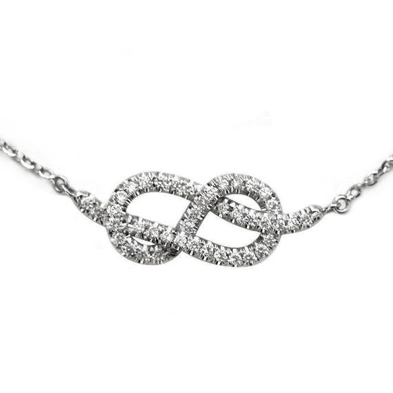 Infinity knot necklace diamond pendant necklace white gold like this item aloadofball Images