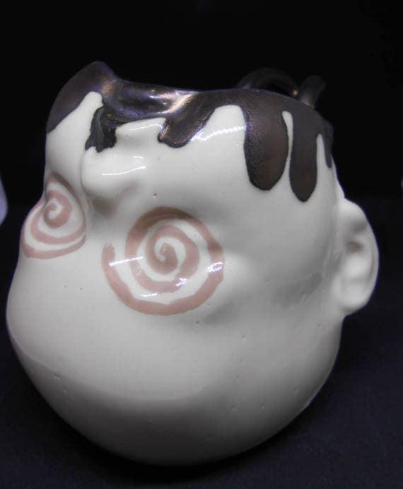 Swirl Eyed Baby Headed Clay Mug