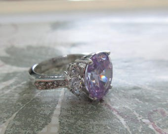 Nice ~ 18K GE ~ STATEMENT RING~ Embellished w/Large Faceted Light Purple Stone and Clear Faceted Stones ~ Approx. Size 5-1/2