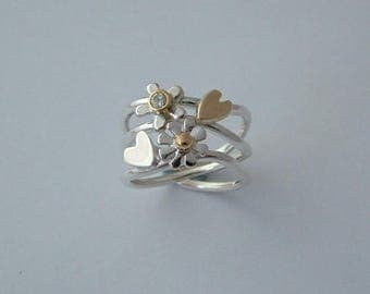 Hearts and flowers sterling silver, gold  diamond ring.