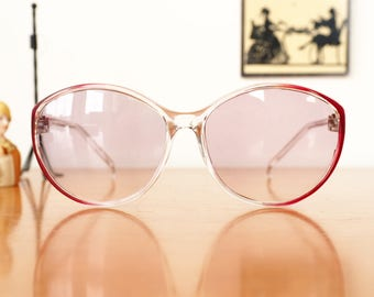 Vintage Sunglasses 1970's Oversized Clear and Red color By Foster Grant New Old Stock Made In USA Lightly Tinted Purple lens Cheap!