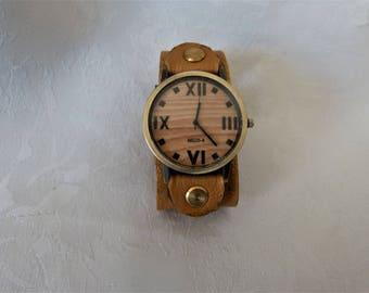 Watch leather bracelet, men, round wooden background.