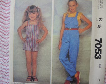 vintage 1980s McCalls sewing pattern 7053 girls jumpsuit overalls size 7