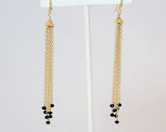 Black spinel gold tassel earrings on gold filled chain and ear wires.    3 1/2 inches from top of ear wire to bottom of longest strand.