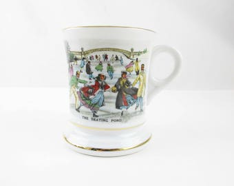 A Victorian Moustache Mug - Multi-colored - Multi-colored 'The Skating Pond' - Gold Striped Detail - Decorated - Moustache  Mug