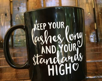 Keep your lashes long and your standards high Large 20 ounce Mug