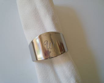 "Six stainless steel monogramed ""W"" napkin rings"