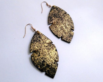 black leather and gold earrings