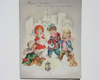 Vintage Unused Christmas Card Featuring Children Caroling on a Clear Night with Silver Glittery Snow and a Cute Dog with Lantern Made in USA