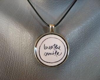 "Zen Attitude ""Breather Smile"" set in resin"