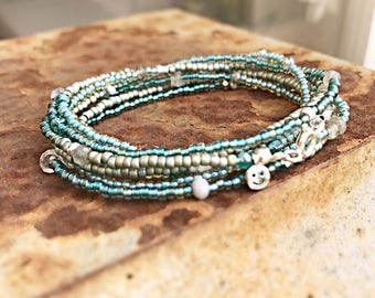 Handmade bracelet/ necklace with blue,green,silver seed beads, crystal and semiprecious beads