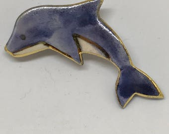 Jumping Dolphin pin supports Marine Science Research.