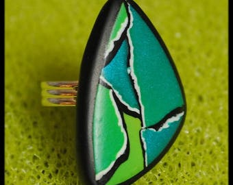 Ring in teal blue green polymer