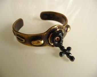 Rock worked brass and black cross bracelet