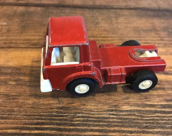 Tootsie 1970 red flatbed truck.