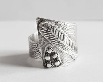 Silver feather symbol ring