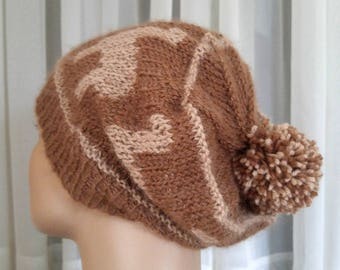 Knit all natural slouchy alpaca pompom beanie   tan alpacas brown background   hand-knit luxury alpaca tan and brown pompom slouch hat