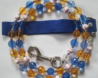 Blue/Gold with baseballs for any pet.