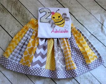 Girls bee birthday outfit. Bumblebee shirt with matching skirt in silver, gray, pink and yellow. Size 2t 3t 4t 5t 6 8 10 12 skirt set.