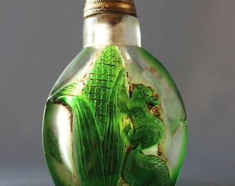 19th century Chinese snuff bottle depicting a squirrel raiding a corn cob