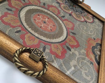 Upcycled vintage gold rectangular frame tray with vintage ring handles and red and grey floral upholstery fabric