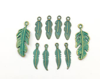 10 feather charms gold tone  and green patina, 26mm to 29mm #CH 285