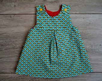 Reversible baby dress with geometric print