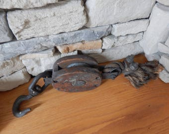 Old wooden and iron pulley