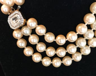 Kennith J Lane three strand faux pearl necklace