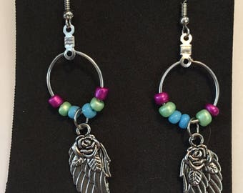 Dangle Hoop Earrings: featuring blue, green, and purple seed beads and Wing charms