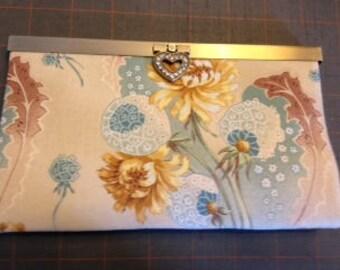 beige floral purse