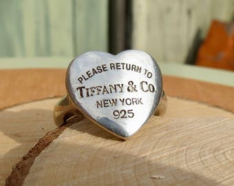 Sold to Steve, Layaway 2, A silver heart shaped Tiffany & Co ring.