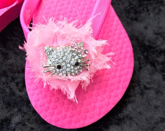 Children's Pink Flips with a Light Pink Shabby Flower and Hello Kitty Brooch - Size 8/9