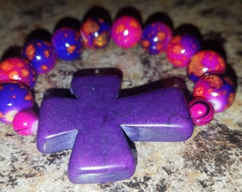 Child's Pink and purple beaded purple cross bracelet