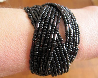 Several rows, black beaded bracelet