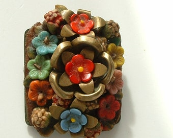 Vintage metal and glass flower brooch