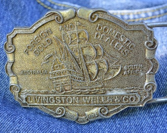 Vintage belt buckle foreign domestic gold dealers Livingston Wells & Co