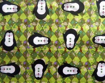 "fabric ""little Penguin"" on green background"