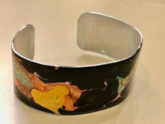 Enamel painted aluminum cuff open bracelet with abstract design (black, orange, yellow, pink, green, blue, green)