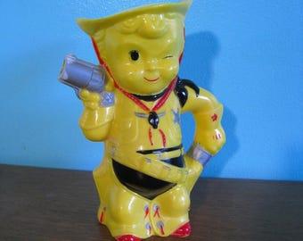 Two Gun Tiny Sheriff Cowboy Vintage Aladdin yellow plastic pitcher. Vintage 1950s collectible
