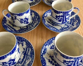 Vintage Japanese demitasse cup and saucer cherry blossom blue and white marked Nihon
