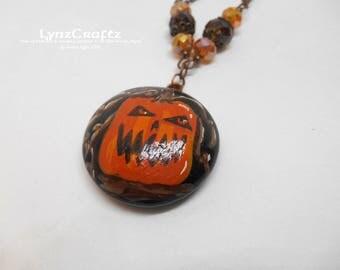 The Jack O Lantern black & orange polymer clay pendant necklace jewelry charm handmade