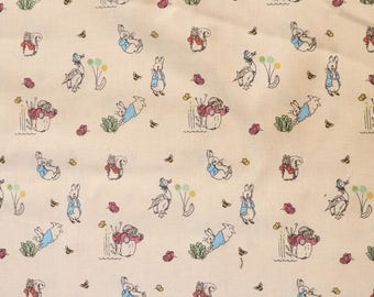 Fabric - Peter rabbit - All the characters - cream - cotton print.