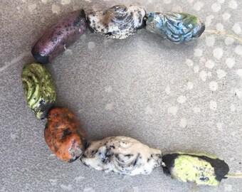 6 beads and tubes'n raku pottery
