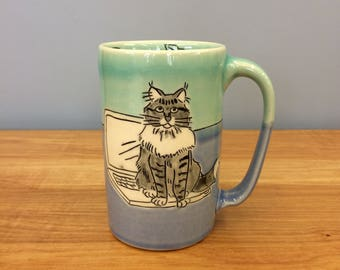 Handmade Mug with Maine Coon Cat on a Computer. Glazed in Aqua & Blue. MA101