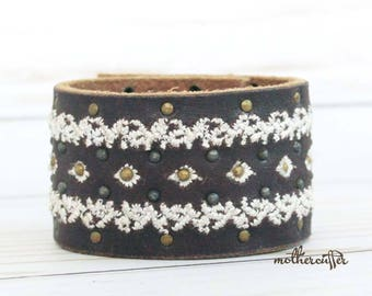 CUSTOM HANDSTAMPED dark brown leather cuff with white stitching and rivet design by mothercuffer