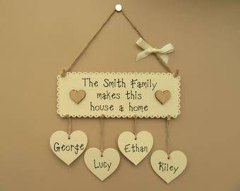 """Personalised Surname Family plaque. """"Family makes this house a home"""" Hanging heart plaque. Housewarming gift. Family sign. Mother's Day."""