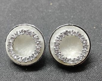 Fancy metallic grey earrings with faux diamonds circles in them