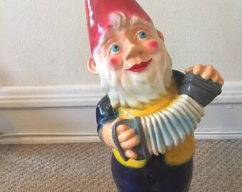 vintage garden gnome statue with accordion